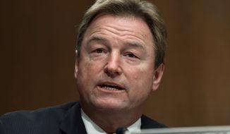 In this Jan. 30, 2018, file photo, Sen. Dean Heller, R-Nev., asks a question of Treasury Secretary Steven Mnuchin during a Senate Banking Committee hearing on Capitol Hill in Washington. (AP Photo/Susan Walsh, file)