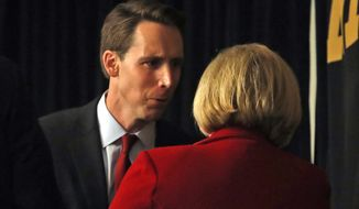 Republican U.S. Senate candidate Josh Hawley, left, talks with incumbent Democratic Sen. Claire McCaskill of Missouri at the end of a candidate forum at the annual Missouri Press Association convention Friday, Sept. 14, 2018, in Maryland Heights, Mo. (AP Photo/Jeff Roberson)