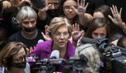 In a Thursday, Sept. 27, 2018 file photo, Sen. Elizabeth Warren, D-Mass., greets womens' rights activists in the Hart Senate Office Building as the Senate Judiciary Committee hears from Brett Kavanaugh and Christine Blasey Ford, his accuser, on Capitol Hill in Washington. Warren, along with Ayanna Pressley, fresh off her primary victory over 10-term U.S. Rep. Michael Capuano in Massachusetts, were in Jonesboro on Tuesday, Oct. 9. 2018 with Democratic candidate Stacey Abrams.  (AP Photo/J. Scott Applewhite, File)