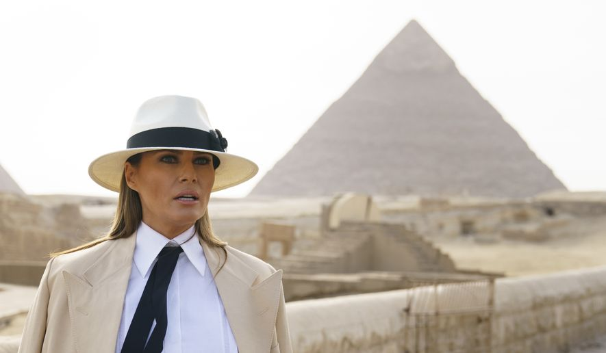 First lady Melania Trump speaks to media as she visits the historic site of Giza Pyramids in Giza, near Cairo, Egypt, Saturday, Oct. 6, 2018. First lady Melania Trump is visiting Africa on her first big solo international trip. (AP Photo/Carolyn Kaster)
