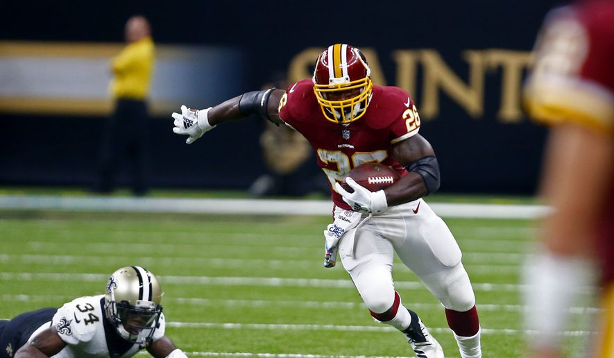 Washington Redskins running back Adrian Peterson (26) carries past New Orleans Saints defensive back Justin Hardee (34) in the first half of an NFL football game in New Orleans, Monday, Oct. 8, 2018. (AP Photo/Butch Dill) ** FILE **