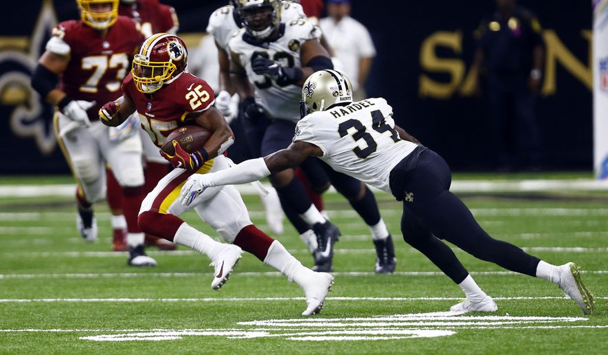Washington Redskins running back Chris Thompson (25) carries against New Orleans Saints defensive back Justin Hardee (34) in the second half of an NFL football game in New Orleans, Monday, Oct. 8, 2018. (AP Photo/Butch Dill)
