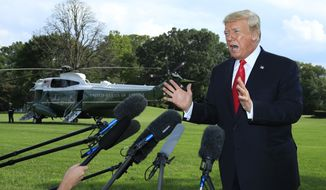 President Donald Trump speaks to reporters on the South Lawn before leaving the White House in Washington, Tuesday, Oct. 9, 2018. (AP Photo/Manuel Balce Ceneta)