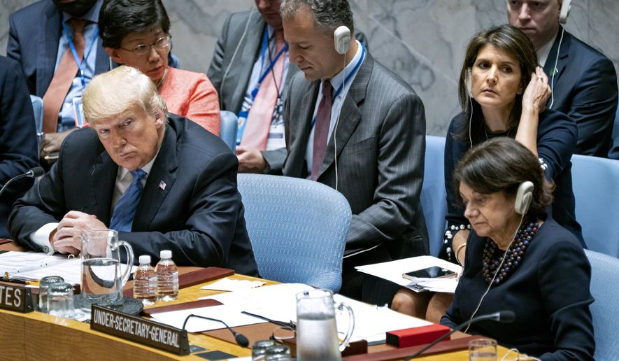 President Donald Trump listens to a council member at a United Nations Security Council meeting during the 73rd session of the United Nations General Assembly, at U.N. headquarters, Wednesday, Sept. 26, 2018. Upper right center is U.S. Ambassador to the United Nations Nikki Haley. (AP Photo/Craig Ruttle)