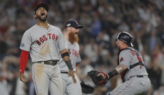 Boston Red Sox third baseman Eduardo Nunez, left, celebrates with relief pitcher Craig Kimbrel, center, and catcher Christian Vazquez after the Red Sox beat the New York Yankees 4-3 in Game 4 of baseball's American League Division Series, Tuesday, Oct. 9, 2018, in New York. (AP Photo/Julie Jacobson)