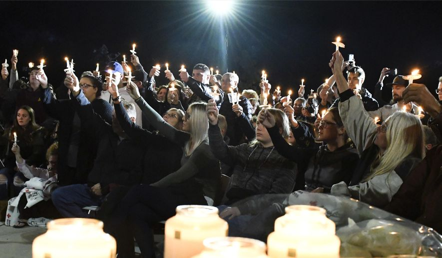 Family members and friends gather for a candlelight vigil memorial at Mohawk Valley Gateway Overlook Pedestrian Bridge in Amsterdam, N.Y., Monday, Oct. 8, 2018. The memorial honored 20 people who died in Saturday's fatal limousine crash in Schoharie, N.Y., (AP Photo/Hans Pennink)