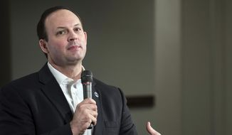 In this Jan. 15, 2016, file photo, South Carolina Attorney General Alan Wilson speaks to the crowd at a Conservative Leadership Project presidential forum, with Republican candidate, Sen. Ted Cruz, R-Texas, in Columbia, S.C. Wilson's inaction impeded an investigation into corruption at the South Carolina Statehouse, whether he intended it to or not, according to a State Grand Jury report released Tuesday, Oct. 9, 2018, after a two-year investigation. (AP Photo/Sean Rayford, File) **FILE**