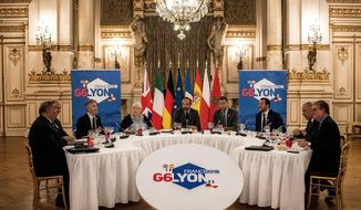 French Prime Minister Edouard Philippe, center, and French Minister attached to the Interior Minister Jacqueline Gourault, center left attends the G6 Interior Ministers' meeting in Lyon, central France, Monday, Oct. 8, 2018. (Jeff Pachoud/Pool via AP)
