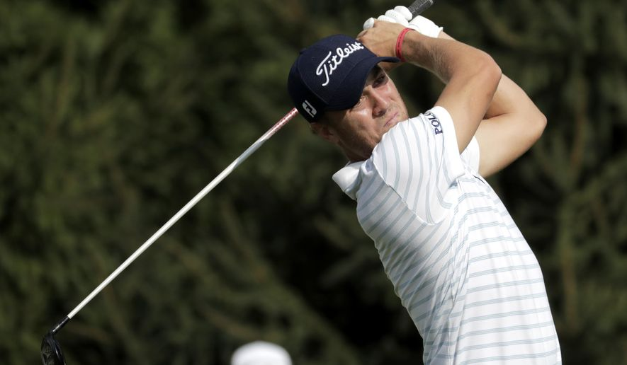 FILE - In this Thursday, Aug. 23, 2018 file photo, Justin Thomas tees off on the 14th hole during the first round of the Northern Trust golf tournament in Paramus, N.J. Tiger Woods finished off the PGA Tour season by tapping in for par to win the Tour Championship, a moment that ended any doubts that he could win again after four surgeries on his lower back. And then the moment was gone as the Ryder Cup began. Overlooked from last season was Justin Thomas being first player to win consecutive money titles since Woods, and Woods winning a fifth tournament in three decades. (AP Photo/Julio Cortez, File)