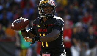 FILE - In this Sept. 23, 2017, file photo, Maryland quarterback Kasim Hill throws to a receiver in the first half of an NCAA college football game against Central Florida in College Park, Md. Maryland interim coach Matt Canada has used both his quarterbacks in all five games this season, jockeying between Kasim Hill and Tyrrell Pigrome in an unyielding effort to get more production from an offense that has relied far too heavily on the run. (AP Photo/Patrick Semansky, File)