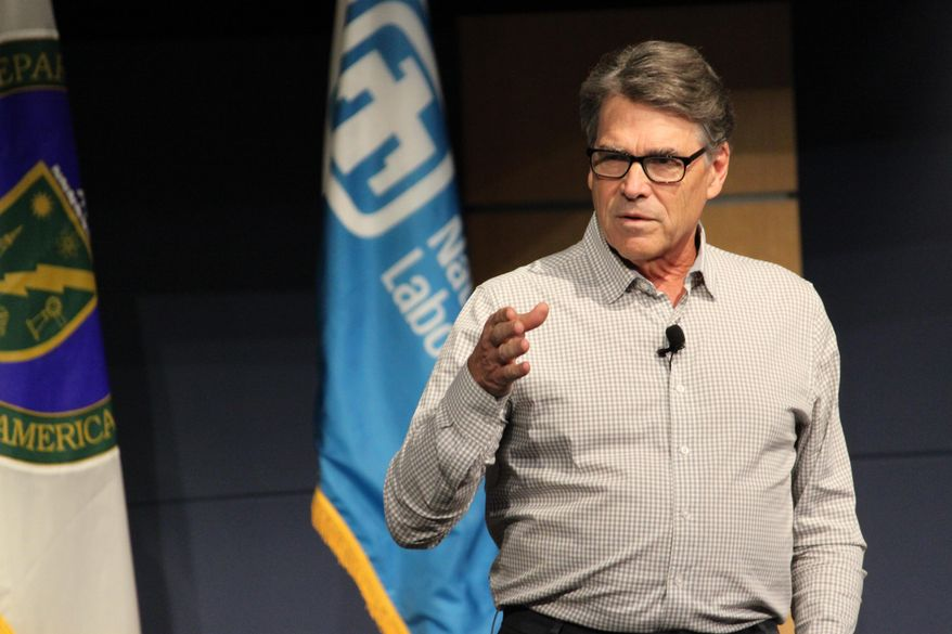 U.S. Energy Secretary Rick Perry speaks to a crowd of employees following at tour of Sandia National Laboratories in Albuquerque, N.M., on Tuesday, Oct. 9, 2018. Perry said he was confident that Sandia and Los Alamos National Laboratory will continue to play significant roles in the nation's weapons program. (AP Photo/Susan Montoya Bryan)