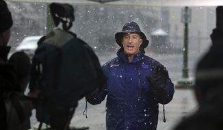 FILE - In this Oct. 29, 2011, file photo, The Weather Channel host, Jim Cantore goes live from Commonwealth Avenue behind the Pennsylvania State Capitol in Harrisburg, Pa. A Florida county threatened by Hurricane Michael is warning a television meteorologist to stay away. The Santa Rosa County Sheriff's Office posted a tongue-in-cheek trespass warning on Facebook for Cantore. Cantore is usually on the scene of major storms. (John C. Whitehead/The Patriot-News via AP, File)
