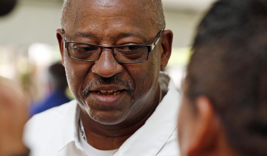 In this July 26, 2017 photo University of Oklahoma's Ruffin McNeill, the assistant head coach and defensive tackles coach, speaks to the media before a golf event at Jimmy Austin Golf Course in Norman, Okla. Oklahoma fired defensive coordinator Mike Stoops on Monday, Oct. 8, 2018 after the Sooners struggled to stop Texas during their first loss of the season. McNeill will be the defensive coordinator for the rest of the season. (Steve Sisney/The Oklahoman via AP)