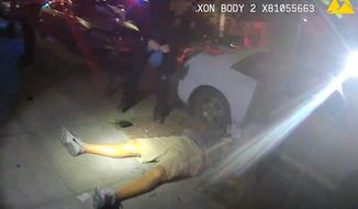 FILE - This June 29, 2018, file video image from a police officer's body cam and provided by Portland State University shows Jason Washington after he was shot and killed by Portland State University police officers in Portland, Ore. Grand jury testimony released by a district attorney Tuesday, Oct. 9, into the fatal shooting by university police of a black man during a brawl outside a Portland, Oregon, bar describes a chaotic scene in which the two officers had to make a split-second decision when they saw a pistol in the man's hand. (Portland State University via AP, File)