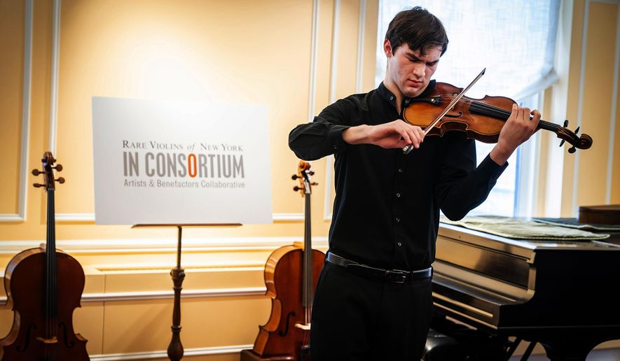 "In this photo provided by Chris Lee, Juilliard student Nathan Meltzer, recipient of the ""Ames, Totenberg"" Stradivari of 1734, plays the instrument in New York on Tuesday, Oct. 9, 2018. The Stradivarius stolen from the late violinist Roman Totenberg and miraculously found more than three decades later has a new life, under the chin of the budding 18-year-old virtuoso. (Chris Lee via AP)"