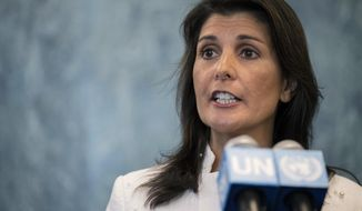 FILE - In this July 20, 2018 file photo, U.S. Ambassador to the United Nations Nikki Haley speaks to reporters at United Nations headquarters. Haley is tendering her resignation, two sources tell The Associated Press, marking the latest shake-up in the turbulent Trump administration just weeks before the midterm election. She was appointed to the U.N. post in November 2016 and last month coordinated Trump's second trip to the United Nations, including his first time chairing the U.N. Security Council. (AP Photo/Mary Altaffer, File)