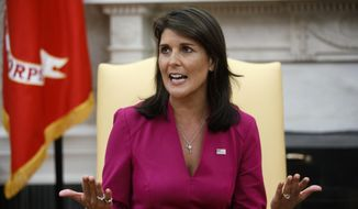 Then-outgoing U.S. Ambassador to the United Nations Nikki Haley speaks during a meeting with President Donald Trump in the Oval Office of the White House, Tuesday, Oct. 9, 2018, in Washington. (AP Photo/Evan Vucci) ** FILE **