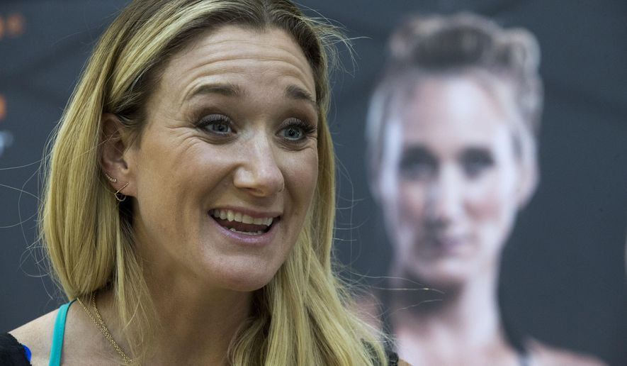 FILE - In this March 22, 2016, file photo, Kerri Walsh Jennings speaks to reporters during a news conference in New York. Three-time beach Olympic volleyball gold medalist Kerri Walsh Jennings has a new partner as she tries to qualify for the 2020 Summer Games in Tokyo. Walsh Jennings tells The Associated Press she will pair with Rio Olympian Brooke Sweat, a defensive specialist. (AP Photo/Mary Altaffer, File)