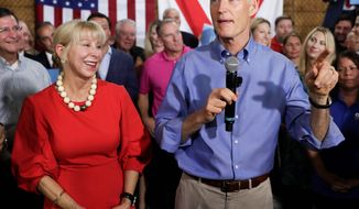 """""""My wife runs her own finances — that may be a hard thing for Sen. [Bill] Nelson to understand,"""" said Gov. Rick Scott in a statement. His finances have been scrutinized, particularly regarding his blind trust and wife Ann Scott's mirrored investments. FILE — In this Monday, April 9, 2018, file photo, Florida Gov. Rick Scott, with his wife, Ann, announces his bid to run for the U.S. Senate at a news conference, in Orlando, Fla. Multimillionaire Scott maintains that he does not have any say over his fortune, but questions are mounting over his finances. (AP Photo/John Raoux, File) (Associated Press)"""