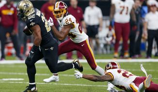 New Orleans Saints running back Mark Ingram (22) rushes for a touchdown past Washington Redskins free safety DeAngelo Hall (23) and cornerback Josh Norman (24) in the first half of an NFL football game in New Orleans, Sunday, Nov. 19, 2017. (AP Photo/Butch Dill)