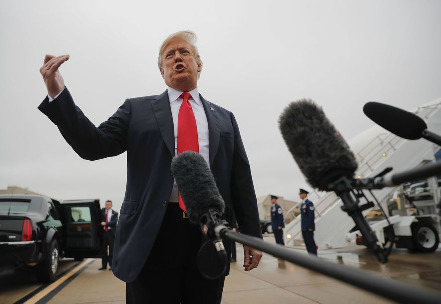 President Donald Trump talks on the tarmac to members of the media during his arrival at Topeka Regional Airport, Saturday, Oct. 6, 2018 in Topeka, Kan. Trump commented on the Senate confirmation of Supreme Court nominee Brett Kavanaugh. (AP Photo/Pablo Martinez Monsivais)