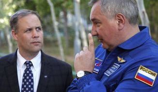Director General of the Russia state corporation Roscosmos Dmitry Rogozin, right, talks with Administrator of the National Aeronautics and Space Administration (NASA) Jim Bridenstine in Russian leased Baikonur cosmodrome, Kazakhstan, Wednesday, Oct. 10, 2018. (Yuri Kochetkov, Pool Photo via AP)
