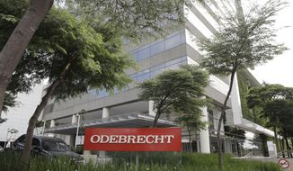 FILE - This April 12, 2018 file photo, shows the Odebrecht headquarters in Sao Paulo, Brazil. Brazilian prosecutors say evidence that could shed light on bribes paid in Mexico by construction giant Odebrecht has been held up because Mexican prosecutors have refused to sign off on terms for exchanging information. (AP Photo/Andre Penner, File)