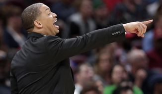 FILE - In this Oct. 6, 2018, file photo, Cleveland Cavaliers head coach Tyronn Lue yells instructions to players in the second half of an NBA preseason basketball game against the Boston Celtics, in Cleveland.  Lue feels re-energized after he was sidelined by health issues last season. Lue battled anxiety and insomnia during a drama-filled season that ended with the Cavs being swept in the Finals by Golden State A longtime assistant, Lue's embracing the chance to mold young players and perhaps show that he had something to do with Cleveland's dominance the past few seasons.(AP Photo/Tony Dejak) ** FILE **