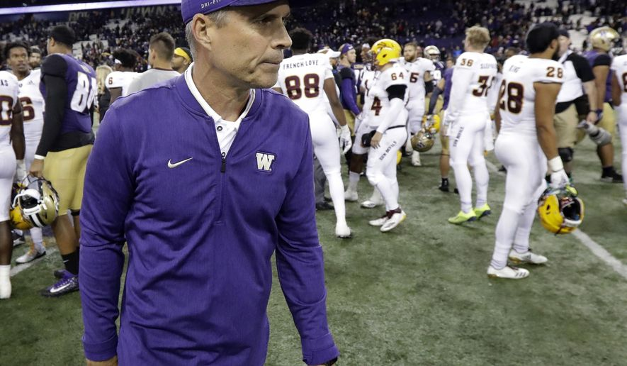 FILE - In this Saturday, Sept. 22, 2018, file photo, Washington head coach Chris Petersen walks off the field following an NCAA college football game against Arizona State in Seattle. If the Pac-12 wants to maximize its already damaged hopes of playing for a national championship No. 7 Washington needs to beat No. 17 Oregon on Saturday.  (AP Photo/Ted S. Warren, File)