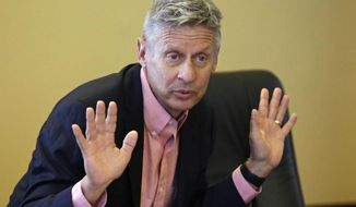 FILE - In this May 18, 2016, file photo, then-Libertarian presidential candidate and former New Mexico Gov. Gary Johnson speaks with legislators at the Utah State Capitol in Salt Lake City. Johnson wants to occupy a potentially powerful swing seat in the U.S. Senate, as Republican and Democrats jockey for the majority in November 2018 elections. (AP Photo/Rick Bowmer, File)
