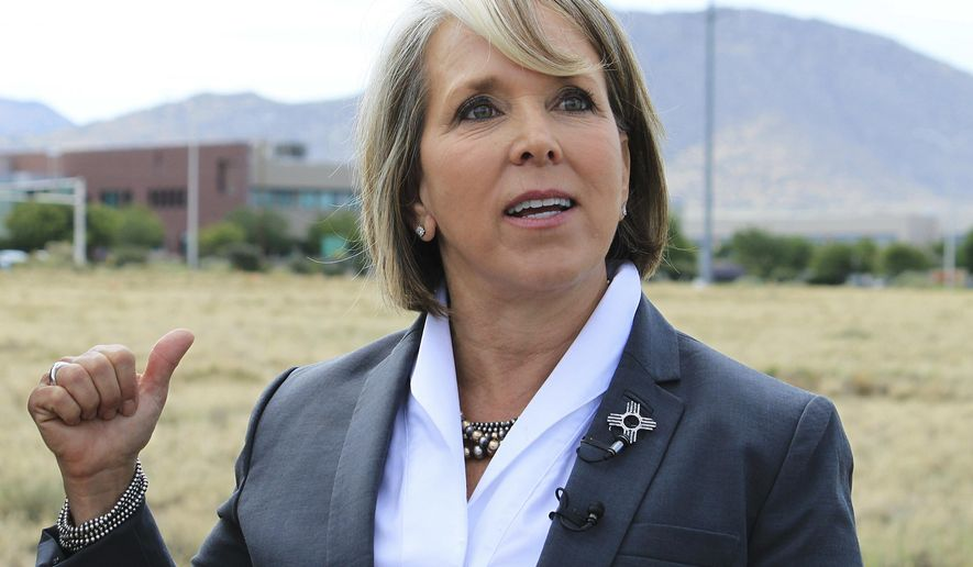 FILE - In this July 2, 2018 file photo, New Mexico Democratic gubernatorial candidate Michelle Lujan Grisham talks about efforts to secure federal funding for a planned multimillion-dollar building for the National Nuclear Security Administration during a groundbreaking ceremony in Albuquerque, N.M. Republican gubernatorial candidate and U.S. Rep. Steve Pearce owns companies that actively lease oilfield equipment even as he campaigns to regulate evenhandedly a booming petroleum sector and expand an oil-dependent economy. Both candidates are campaigning on plans to diversify the state economy and move New Mexico away from energy's boom-and-bust cycles. (AP Photo/Susan Montoya Bryan, File)
