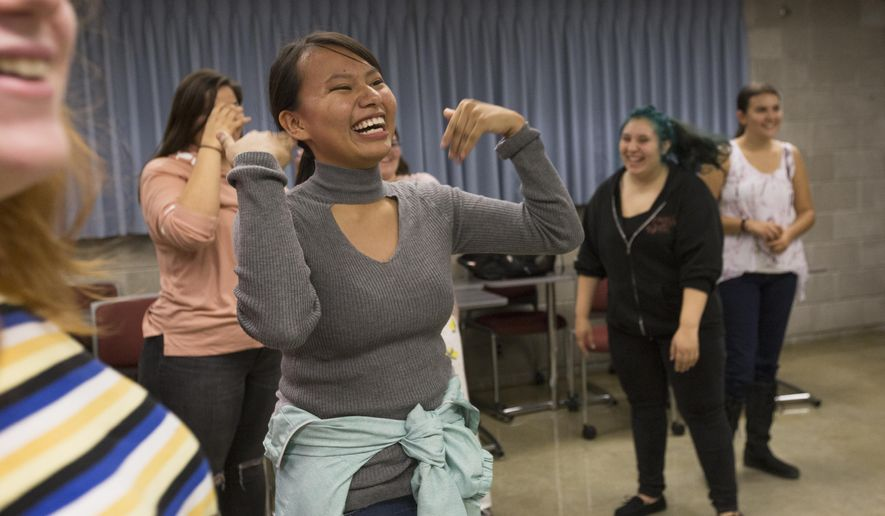 Native American Studies student Claudia Iron Hawk fans herself during her traditional Native American dance class on Wednesday, Oct. 3, 2018, at the University of Minnesota-Morris campus. (Ellen Schmidt/The Minnesota Daily via AP)
