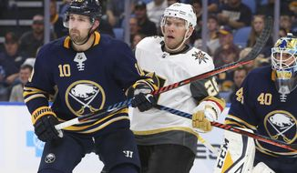 Buffalo Sabres forward Patrik Berglund (10) and Vegas Golden Knights forward Paul Stastny (26) battle in front of net during the second period of an NHL hockey game, Monday, Oct. 8, 2018, in Buffalo N.Y. (AP Photo/Jeffrey T. Barnes)