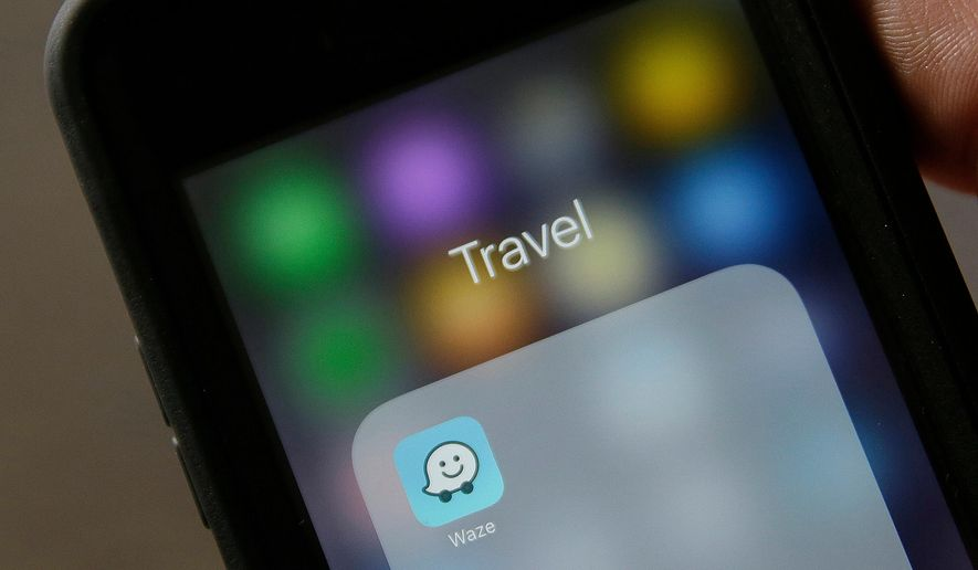In this March 27, 2017, file photo, the Waze application is displayed on a smartphone in San Francisco.  (AP Photo/Eric Risberg, File)