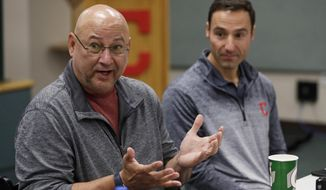 Cleveland Indians manager Terry Francona, left, speaks during a news conference, Wednesday, Oct. 10, 2018, in Cleveland, as President of baseball operations Chris Antonetti looks on. The Indians were so close in 2016, when they took the Chicago Cubs into extra innings in Game 7 of the World Series. Now they've lost six straight playoff games. (AP Photo/Tony Dejak)