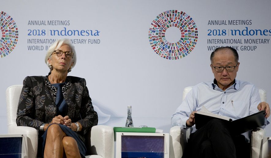 Managing Director of International Monetary Fund (IMF) Christine Lagarde, left, and World Bank President Jim Yong Kim attend a trade conference in Bali, Indonesia Wednesday, Oct. 10, 2018. (AP Photo/Firdia Lisnawati)