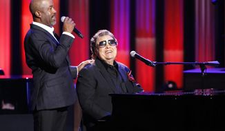"""In this Oct. 8, 2018, photo, host Darius Rucker, left, introduces Ronnie Milsap during """"An Opry Salute to Ray Charles"""" at the Grand Ole Opry House in Nashville, Tenn. (AP Photo/Mark Humphrey)"""