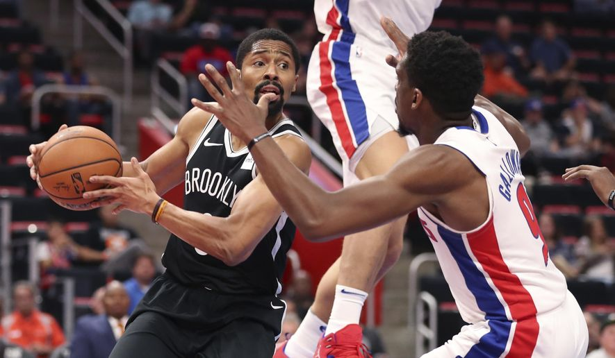 Brooklyn Nets guard Spencer Dinwiddie, left, looks to pass around Detroit Pistons guard Langston Galloway (9) during the first half of an NBA preseason basketball game, Monday, Oct. 8, 2018, in Detroit. (AP Photo/Carlos Osorio)