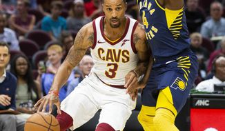 Cleveland Cavaliers guard George Hill (3) dribbles around Indiana Pacers guard Victor Oladipo (4) during the first quarter of an NBA preseason basketball game, Monday, Oct. 8, 2018, in Cleveland. (AP Photo/Scott R. Galvin).