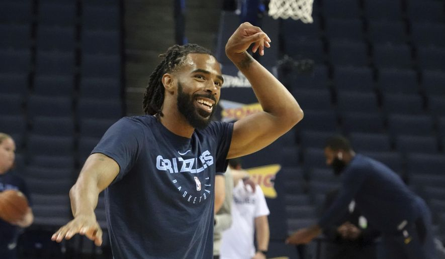 Memphis Grizzlies Mike Conley (11) warms up before the first half of a preseason NBA basketball game against the Indiana Pacers, Saturday, Oct. 6, 2018, in Memphis, Tenn. (AP Photo/Karen Pulfer Focht)