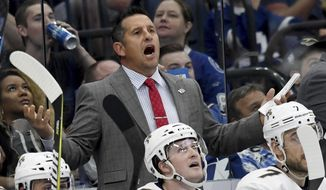 Florida Panthers coach Bob Boughner yells from the bench during the third period of an NHL hockey game against the Tampa Bay Lightning Saturday, Oct. 6, 2018, in Tampa, Fla. (AP Photo/Jason Behnken)