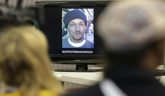 "FILE - In this Dec. 11, 2015 file photo an image of Mario Woods, who was fatally shot by police, is shown on a monitor at a news conference at Southeast Community College in San Francisco. A federal judge says video of the racially charged fatal San Francisco police shooting ""casts doubt"" on officers' accounts that Woods, a 26-year-old black man, was moving quickly toward them when they shot. The judge cited the videos Tuesday, Oct. 9, 2018, when he refused to toss out a wrongful death lawsuit filed by the victim's family against the officers. Five officers shot Woods a combined 21 times in December 2015. The shooting sparked weeks of protest over the department's treatment of minorities. (AP Photo/Jeff Chiu, File)"