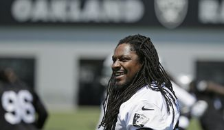 FILE - In this May 23, 2017, file photo, Oakland Raiders running back Marshawn Lynch stretches during NFL football practice in Alameda, Calif. Oakland may always be home for Lynch but Seattle was the city that truly made him a star. The Seahawks (2-3) will get an up-close look at Lynch again this week for the first time since he retired following the 2015 season when they travel to London to face the Raiders (1-4).  (AP Photo/Eric Risberg, File)