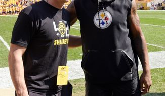 FILE - In this Sunday, Oct. 7, 2018, file photo, Pittsburgh Steelers injured linebacker Ryan Shazier, right, poses with Pittsburgh Penguins NhL hockey player Sidney Crosby before an NFL football game against the Atlanta Falcons in Pittsburgh.  Shazier will be back in Cincinnati on Sunday, but in an entirely new role for the Pittsburgh Steelers. Ten months after sustaining a spinal injury that threatened his career, the linebacker is thriving as a de facto coach. (AP Photo/Don Wright, File)