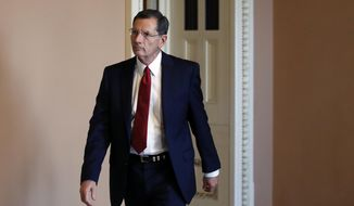 Sen. John Barrasso, R-Wyo., heads to the Senate floor, on Capitol Hill, Wednesday, Oct. 3, 2018, in Washington. (AP Photo/Alex Brandon) ** FILE **
