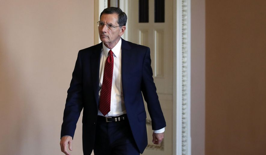 Sen. John Barrasso, R-Wyo., heads to the Senate floor, on Capitol Hill, Wednesday, Oct. 3, 2018, in Washington. (AP Photo/Alex Brandon) ** FILE **