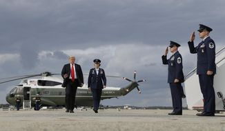 President Donald Trump boards Air Force One for a campaign rally in Erie, Pa., Wednesday, Oct. 10, 2018, in Andrews Air Force Base, Md. (AP Photo/Evan Vucci)