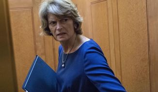 """Sen. Lisa Murkowski, R-Alaska, turns to answer a reporter's question after the Democratic policy luncheon on Capitol Hill, Wednesday, Oct. 10, 2018 in Washington. Murkowski is brushing back against President Donald Trump, saying she knows her state's political terrain """"better than he does.""""Trump says voters """"will never forgive"""" Murkowski for opposing Brett Kavanaugh's nomination to the Supreme Court, and he says the senator will """"never recover"""" politically.  (AP Photo/Alex Brandon)"""