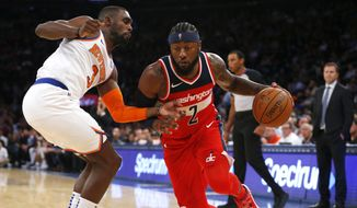 New York Knicks guard Tim Hardaway Jr. (3) defends against Washington Wizards guard John Wall (2) during the first half of a preseason NBA basketball game Monday, Oct. 8, 2018, in New York. (AP Photo/Noah K. Murray) **FILE**