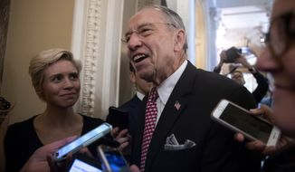 Senate Judiciary Committee Chairman Chuck Grassley, R-Iowa, speaks to reporters as he leaves the chamber following a procedural vote to advance the confirmation of Supreme Court nominee Brett Kavanaugh, at the Capitol in Washington, Friday, Oct. 5, 2018. (AP Photo/J. Scott Applewhite)
